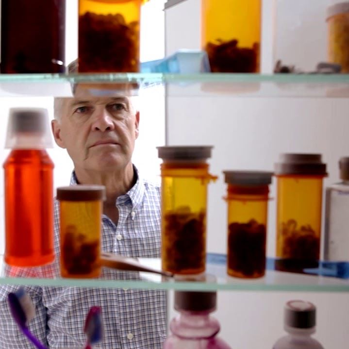 Man looking in his medicine cabinet